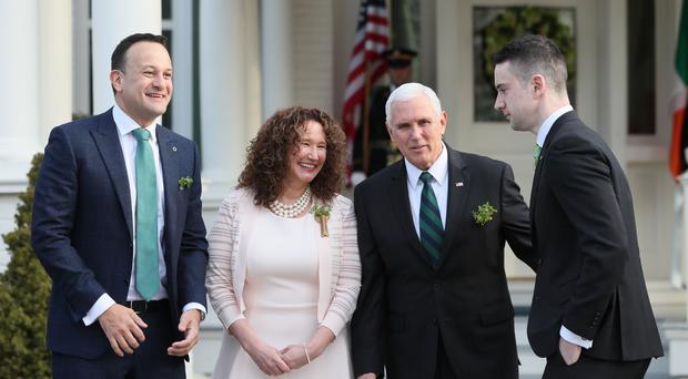 Taoiseach Leo Varadkar (left), who is on an official visit to the United States, is accompanied by his partner Matt Barrett (right) as he stands in a group photograph with the US Vice President Mike Pence (second right) and the VP's sister Anne Pence Poynter (Brian Lawless/PA)