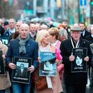 Families of those who died march through the Bogside yesterday