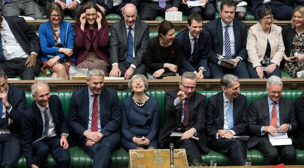 Prime Minister Theresa May enjoys a lighter moment during the Brexit debate in the Commons yesterday