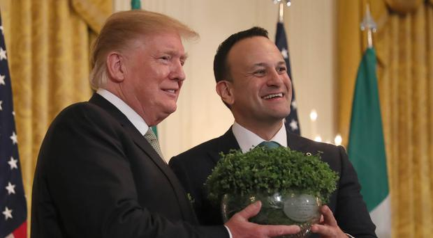Leo Varadkar presents Donald Trump with a bowl of shamrock (Brian Lawless/PA)