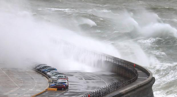 Waves crashed on to cars on the harbour arm at the Port of Dover in Kent as Storms Gareth swept across the country (Gareth Fuller/PA)