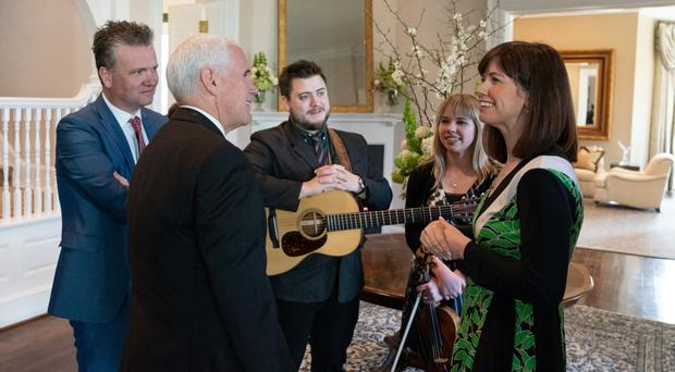 Keith (left) and Kristyn Getty (right) and band members Zach and Maggie White speak with US Vice President Mike Pence in Washington DC