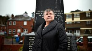 Jean Hegarty at the Bloody Sunday memorial at Free Derry Corner. Her brother Kevin McElhinney was killed, aged 17, in the Army massacre