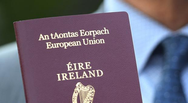 230,000 passport applications were received so far this year, Tanaiste Simon Coveney has announced. (Brian Lawless/PA)