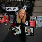 Antoinette Keegan holds pictures of her two sisters who died in Stardust fire in 1981