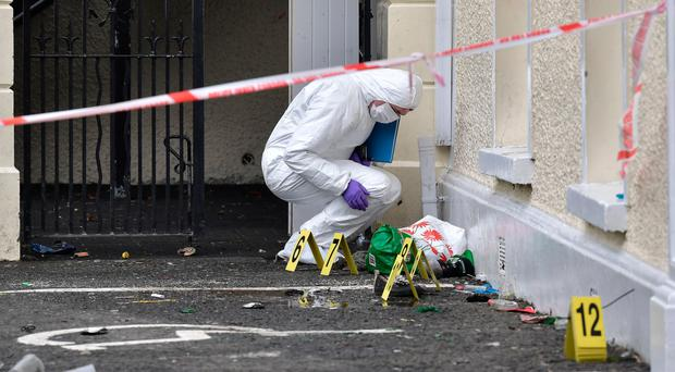 A police forensic officer outside the Greenvale Hotel