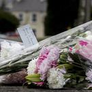 Flowers left in tribute at The Greenvale Hotel in Cookstown, Co Tyrone (Liam McBurney/PA)