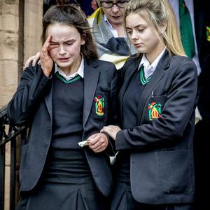 A memorial service is held at Holy Trinity Church in Cookstown yesterday to pay tribute to Lauren Bullock, Morgan Barnard and Connor Currie