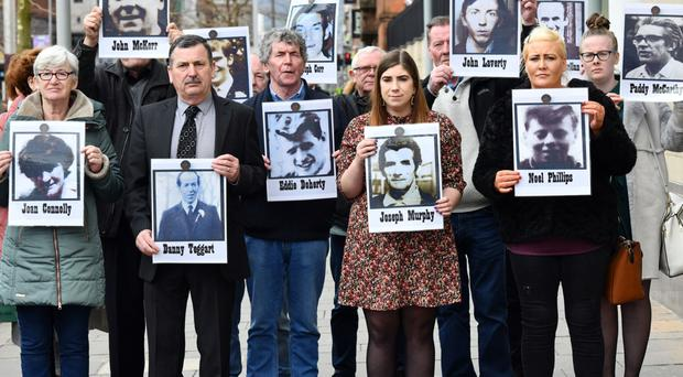 Relatives of the dead outside the inquest in Belfast yesterday