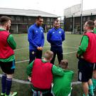 Northern Ireland internationals Josh Magennis and Niall McGinn chat to inmates at Maghaberry Prison yesterday