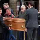 The remains of Morgan Barnard are returned to the family home in Springdale, Dungannon, yesterday