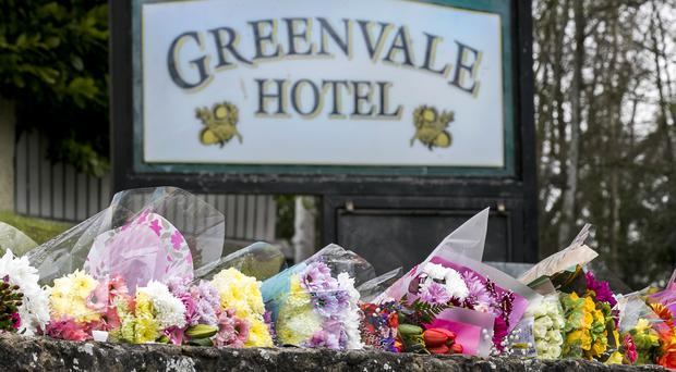 Floral tributes outside the Greenvale Hotel in Cookstown, Co Tyrone (Liam McBurney/PA)