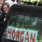 Morgan's mother Maria Barnard is held by her partner James Bradley as they follow the funeral cortege (Brian Lawless/PA)