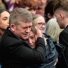 Maria Barnard, the mother of Morgan Barnard, comforted by his father Jimmy Bradley at the funeral of their son, one of the three victims of a crush at a St Patrick's night disco at the Greenvale Hotel in Cookstown