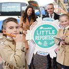 Belfast Telegraph Editor Gail Walker and Translink Group CEO Chris Conway get some help to launch this year's Little Reporters competition