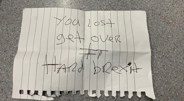The note passed to Emmett Polland by a man on a train (Emmett Polland/PA)