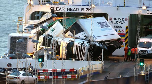 Toppled lorries on the European Causeway, which was travelling from Larne to Cairnryan when it was caught in high winds last December
