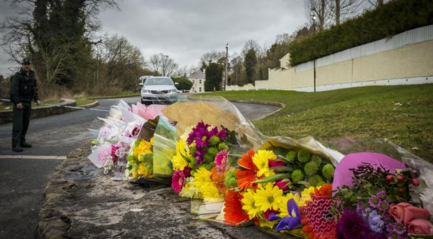 Flowers left near the Greenvale Hotel where three teenagers died