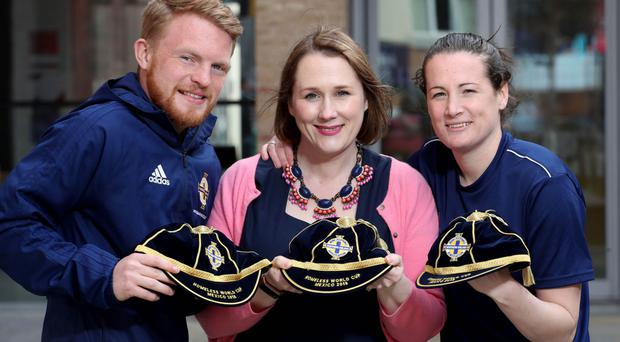 Moira Doherty presents best players Brian Lindsay and Kiera Moss with their caps