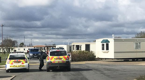 Police officers at Ballyhalbert Caravan Park in Co Down where fresh searches have been taking place (Rebecca Black/PA)