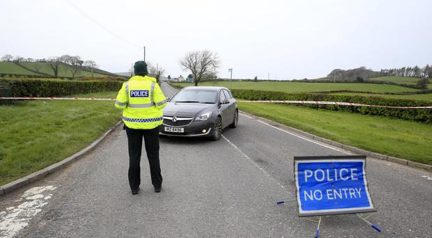 Police at the scene of the accident on the Castleward Road