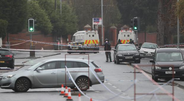 Police at the scene where Jim Donegan was shot dead in Glen Road, West Belfast (Niall Carson/PA)