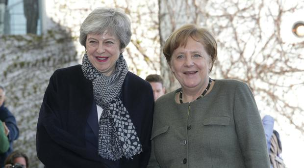 German Chancellor Angela Merkel, right, welcomes Prime Minister Theresa May in Berlin (Michael Sohn/AP)