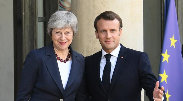 Prime Minister Theresa May with French President Emmanuel Macron (Stefan Rousseau/PA)