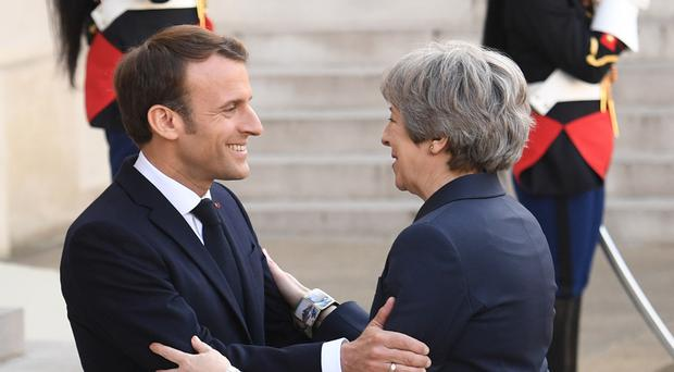 Prime Minister Theresa May with French President Emmanuel Macron ahead of Brexit talks in Paris (Stefan Rousseau/PA)