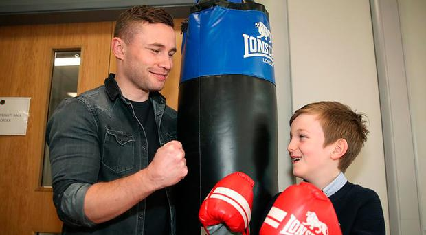 Belfast boxer Carl Frampton with eight-year-old Tom Noble, whose late grandfather was the first principal of Erne Integrated College in Enniskillen
