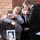 Kerry Lee's daughter Aoife holds a picture of her mum at the funeral