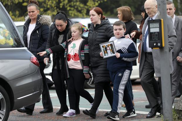 Daughter Rhia (pink jumper) and son Caodhan (carrying picture) with aunt Monica (red hair) and best friend Colleen McNally