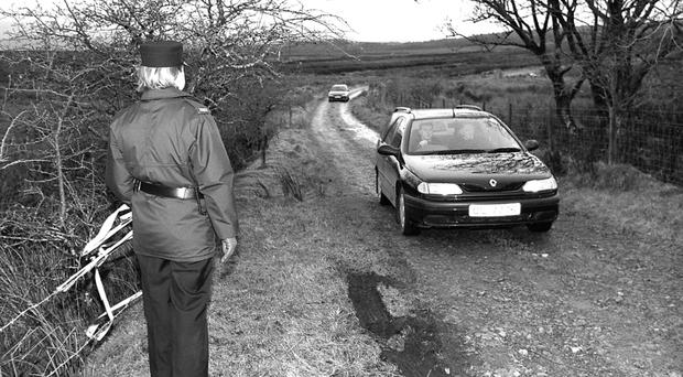 The hearse leaving the scene at Killygreen, Belcoo, following the discovery of the remains of sex abuser David Sullivan