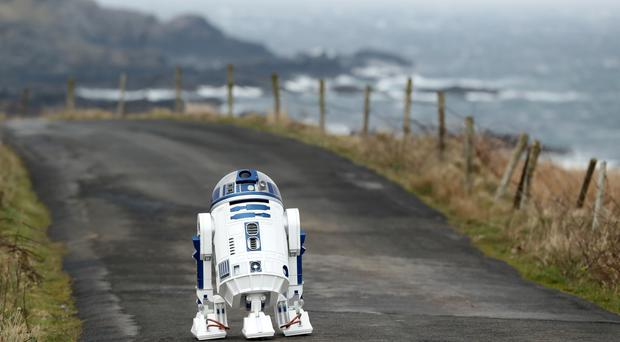 A replica of an R2D2 droid built by Jack Hanna and his father Adrian, from Downpatrick, at the opening of the R2D2 road in Malin Head, County Donegal, Ireland (Niall Carson/PA)