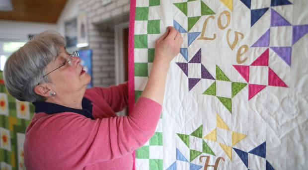 Anne Marcus and some of the quilts that are to go on display