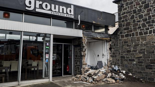 The scene in Market Square in Bushmills, Co Antrim, after a digger was used in an early-morning attack to rip an ATM from the wall of a shop (Liam McBurney/PA)