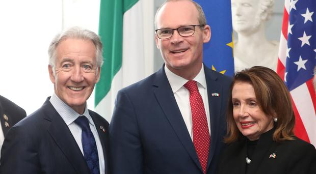 US House of Representatives speaker Nancy Pelosi (right) and Congressman Richard Neal (left) are greeted by Simon Coveney, Ireland's Tanaiste and Minister for Foreign Affairs and Trade at Iveagh House, Dublin (Niall Carson/PA)
