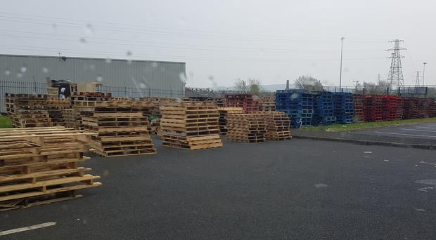 Pallets are being stored in the car park of Avoniel Leisure Centre to be burnt on a bonfire on July 11 (PA)