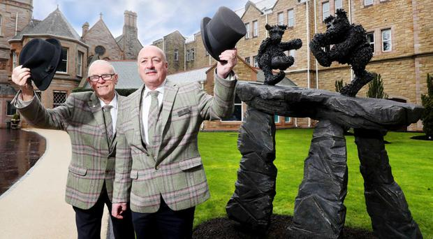 Helping to launch the Art In The Garden exhibition with Patrick O'Reilly's sculpture Bears Dancing On A Dolmen are Culloden commisionnaire Jeremy Kevan and concierge,Trevor Kelso