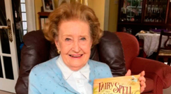 Christine Lynch with a book about the hoax