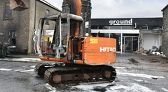 The scene in Market Square in Bushmills, Co Antrim, earlier this week after a digger was used to rip an ATM from the wall of a shop