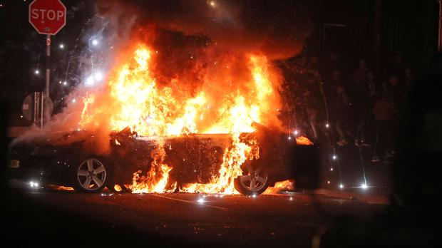 A burning car in Creggan, Londonderry on the night of April 18 (Niall Carson/PA)
