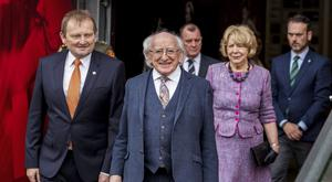 Irish President Michael D Higgins (centre) and his wife Sabina Coyne walk through the tunnel in the National Stadium at Windsor Park, Belfast, with IFA President David Martin (left) to watch players from the Cliftonville and Linfield U9 girls' teams (Liam McBurney/PA)