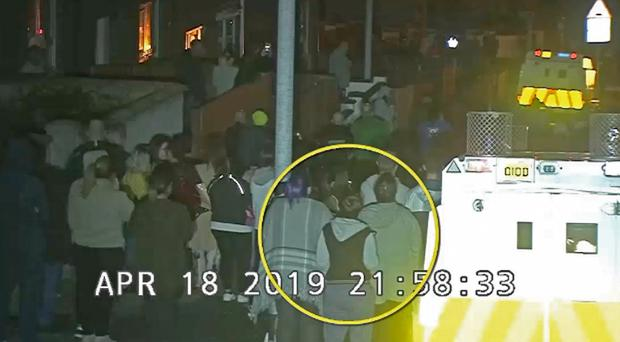 CCTV image of Lyra McKee (circled) within the crowd watching a protest in Londonderry before she was shot (PSNI/PA)