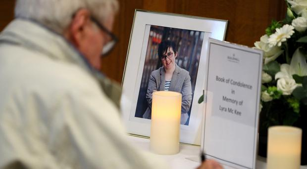 People sign a book of condolence for murdered journalist Lyra McKee at the Guildhall in Londonderry (Brian Lawless/PA)