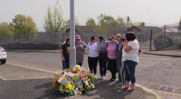 Lyra McKee's death should help end the use of guns in Londonderry, one of her close friends urged after visiting the scene of her shooting (Michael McHugh/PA)