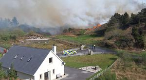 A house near Cionn Casslach in Co Donegal. Air Corps helicopters and army personnel have been called in to help firefighters battle a large gorse fire in Co Donegal (Evelyn Sweeney/PA)