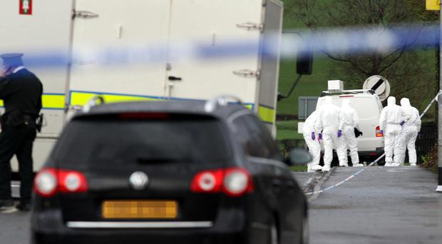 Police forensic experts at the scene where Ronan Kerr died (Paul Faith/PA)