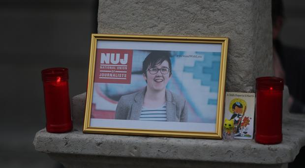 A image of Lyra McKee displayed during a vigil in Dublin (Niall Carson/PA)