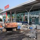Two cash machines were ripped from the wall of the Tesco store in Crumlin, Co Antrim on Friday